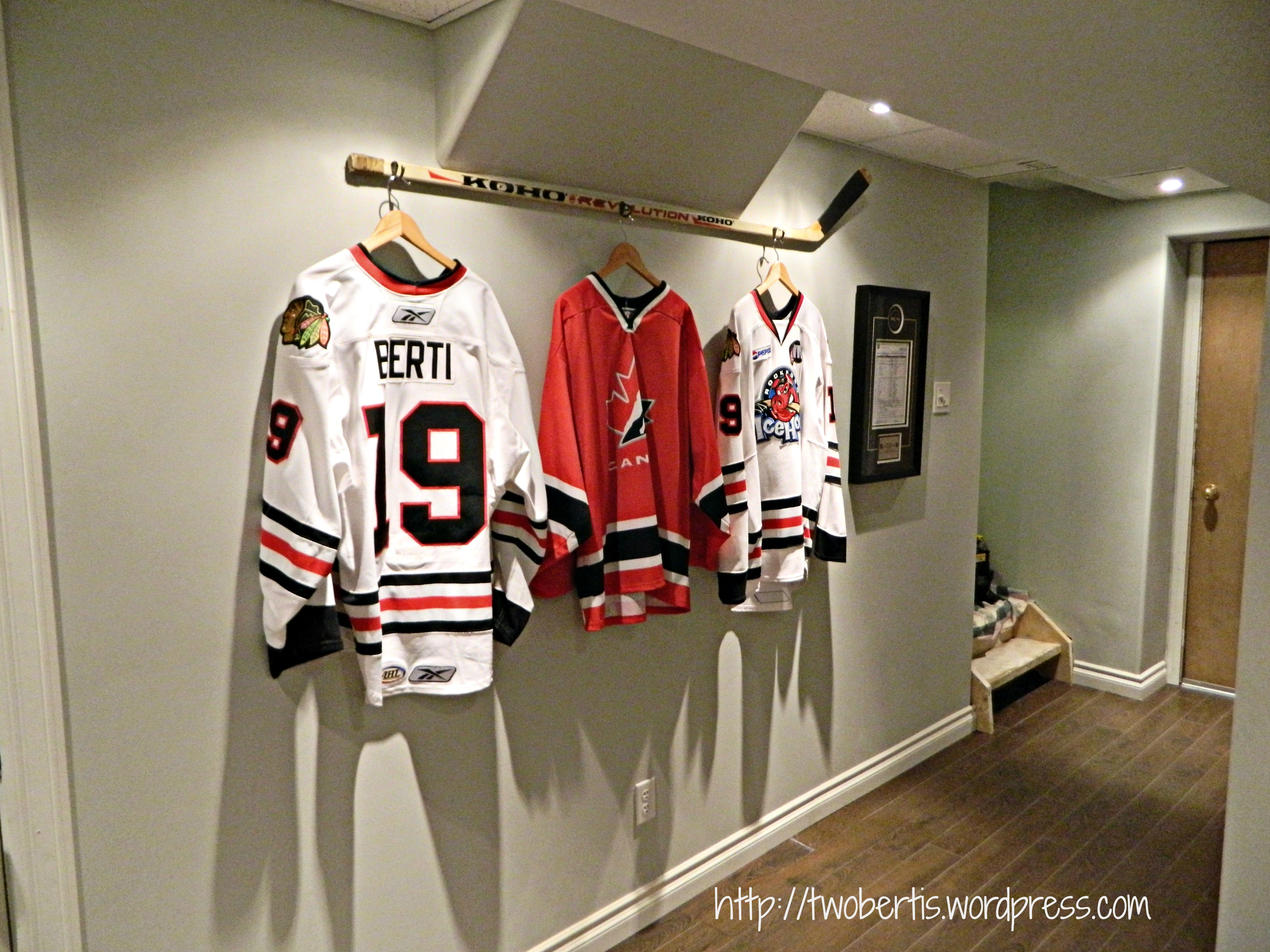 hanging a hockey stick with jerseys twobertis. Black Bedroom Furniture Sets. Home Design Ideas